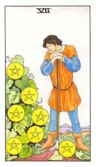 The seven of pentacles tarot card from the Universal Waite deck